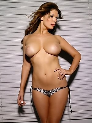 Nicci Campen is a little bit bashful about flashing her neighbors so she closes the Venetian blinds before unleashing her huge DD hooters for your vie